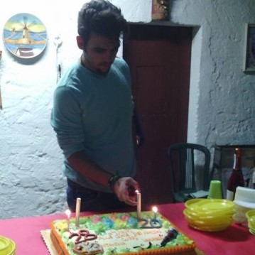 Giuseppina Licari Ignazio lights the candles on Nina and his birthday cake