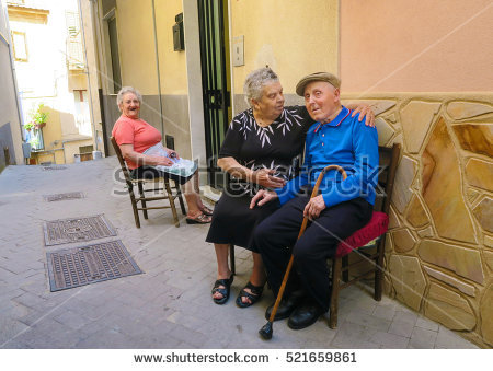 stock-photo-italy-nicosia-august-elderly-people-are-passing-their-afternoons-in-the-shady-narrow-521659861