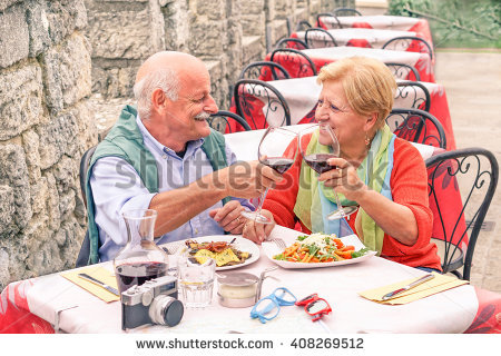 stock-photo-senior-couple-drinking-and-eating-in-bar-outdoor-man-having-fun-and-smiling-with-her-wife-in-408269512